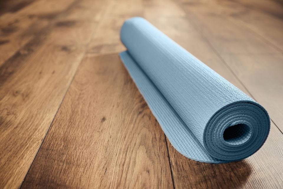 Yoga mat on clean hardwood flooring