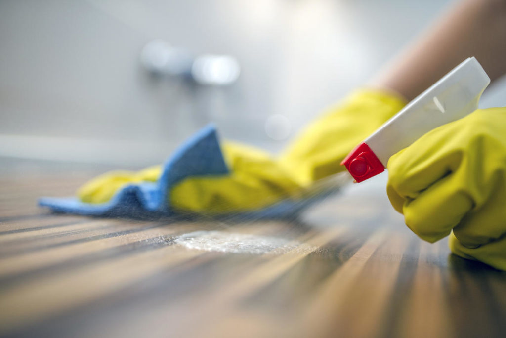 Cleaning Wood Flooring with Latex Gloves | Picture Perfect Cleaning