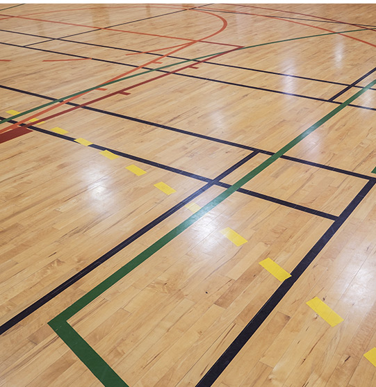 Basketball court at a gymnasium   Gym Cleaning by Picture Perfect Cleaning