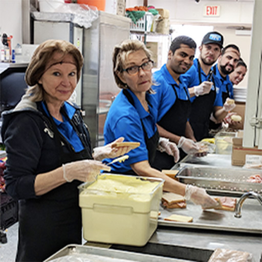 Picture Perfect Cleaning team preparing sandwiches for the homeless