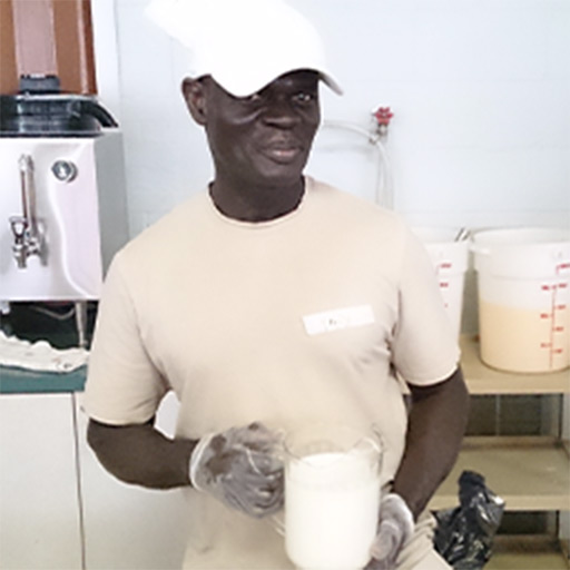 A black individual holding a pitcher of milk | Picture Perfect Cleaning community support