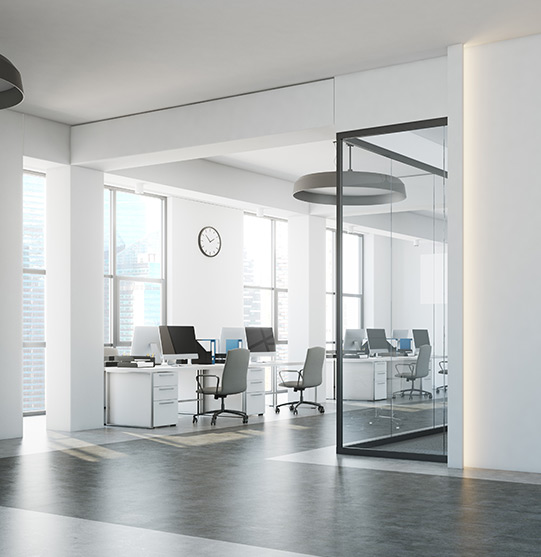 Skyscraper building room with a row of desks and windows | Commercial office and retail cleaning by Picture Perfect Cleaning