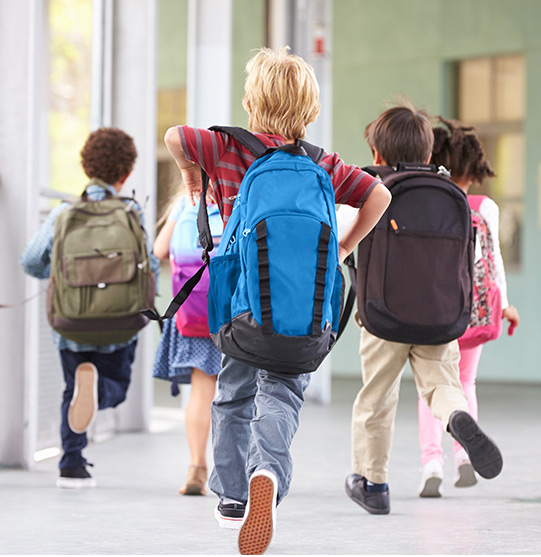 Elementary school students with backpacks | Picture Perfect Cleaning